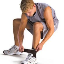 Athlete putting on an ankle bbrace