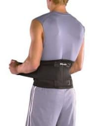 Man wearing a back brace to prevent injury