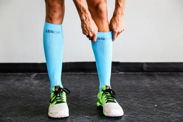 Man wearing a pair of Legend compression socks.