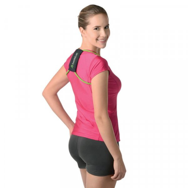 Woman wearing the PostureMedic Posture Perfector