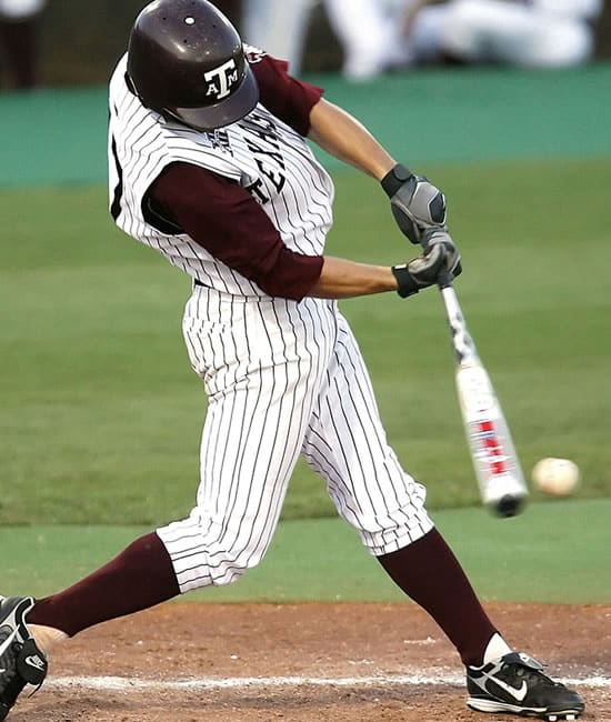 Baseball batter swinging at a pitch. Many back injuries in baseball can be traced back to repeated performance of this motion.