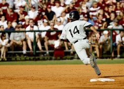 Baseball Batter Sprinting Between Bases. The intense spring required of baseball players can led to shin splints of other damage and the need to wear shin supports for baseball activity.