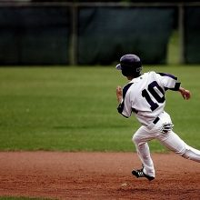 Baseball Player rounding the bases