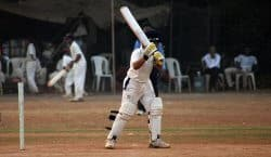 Batsman waiting to take strike.Batsmen struck by the cricket ball may need treatment using compresses for cricket.