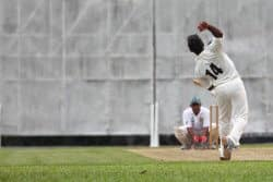 This photo shows a bowler in his delivery action and the stress that it places on the shoulder joint. It illustrates why bowlers may need to use a shoulder support for cricket related injuries.