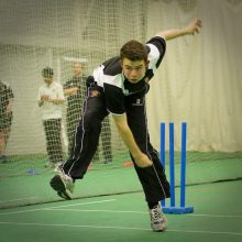 Cricketer Bowling In Net Practice- The strain on the body from this bowling action increases the importance of kinesiology tape for cricket players