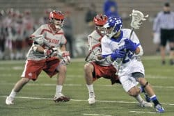 Lacrosse players competing for the ball. Lacrosse places severe athletic demands on the body and can cause kneeinjuries that are treatable by wearing knee braces.
