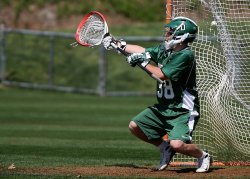 A Lacrosse goalkeeper trying to block a shot. Goalkeepers and other lacrosse players are vulnerable to groin injuries. Athletic supporters for lacrosse goalkeepers are therefore an important injury prevention measure.