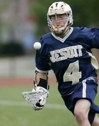 A lacrosse player juggling the ball on his stick. For some hand and wrist injuries suffered while playing lacrosse, a wrist brace can play an important role in the healing process.
