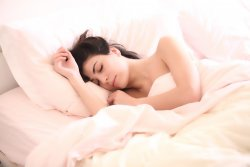 A woman sleepng. Getting plenty of rest is key to treating a concussion injury at home.