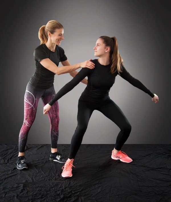 Two women exercising. Exercising with a partner will reduce boredom and help keep you fit while staying home.
