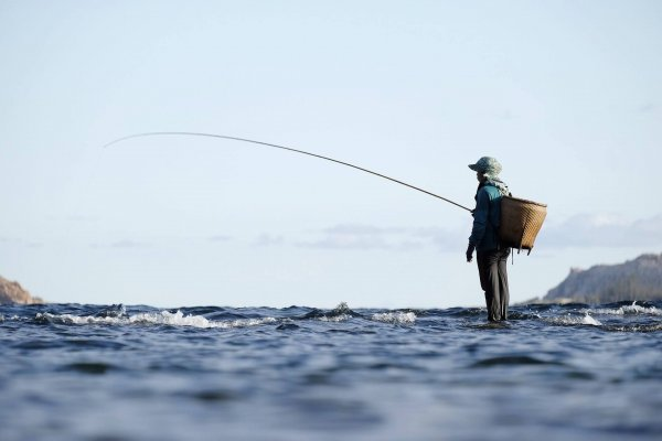 This image shows a man fishing. This is one of the most popular outdoor activities in North America.