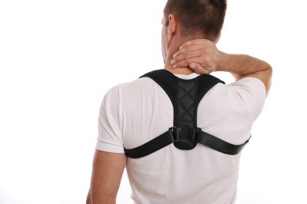 Man wearing an upper back brace (posture brace)