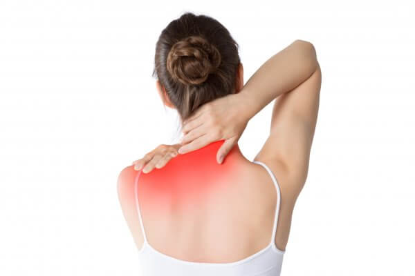 Woman clutching painful neck and upper back