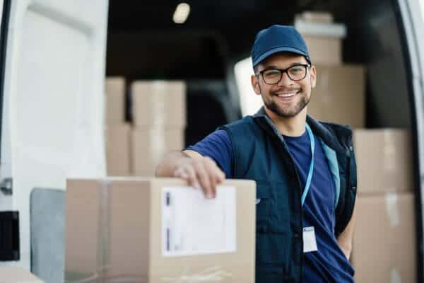 Delivery Worker unloading boxes after shipping quote is provided.