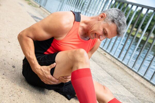 Close-up Of A Mature Man With Sprain Hamstring Muscle