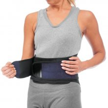 Woman putting on a back brace