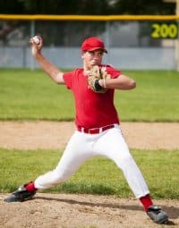 Baseball player throwing a pitch